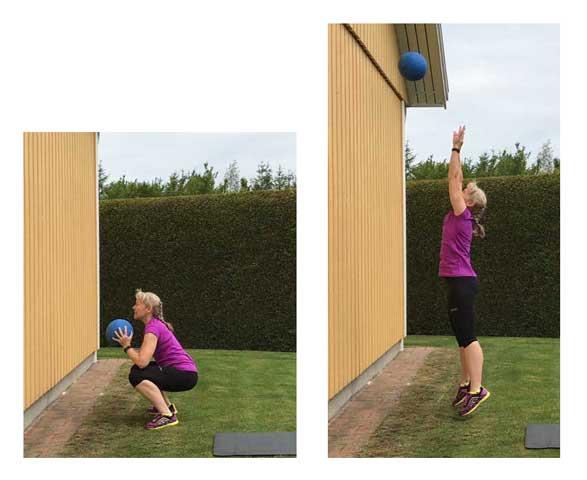 Uppkast med medicinboll mot en vägg för ben och axlar.